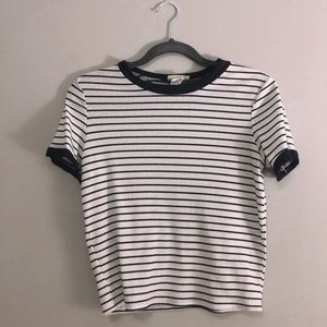 a black and white striped top with navy lining